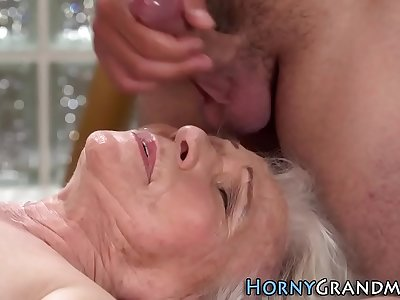 Massaged granny facialized