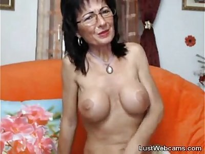 Busty mature masturbates on webcam